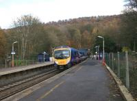 TransPennine DMU no 185110, having just cleared the west portal of Totley Tunnel, rushes through Grindleford Station on 7 November 2010.<br><br>[John McIntyre&nbsp;07/11/2010]