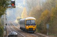 FGW DMU 165109 arrives at Gomshall station on the North Downs in a sylvan setting on 30 October 2010. The service is heading to Redhill from Reading and is on the boundary between Guildford and Reigate Signalling Centres.<br><br>[John McIntyre&nbsp;30/10/2010]