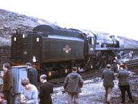 Britannia Pacific no 70013 <I>Oliver Cromwell</I> backs onto the BR (Scottish Region) Easter Grand Tour at Hellifield on 13 April 1968. The Pacific took the train on to Stockport via Blackburn, Bolton and Manchester.<br><br>[Jim Peebles&nbsp;13/04/1968]