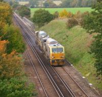 An MPV on RHTT duties heads south east through rural Kent at Tutt Hill, to the north west of Ashford, on 28 October 2010. The large wall behind the MPV to the right of the line is part of a bridge over the M20 Motorway.<br> <br><br>[John McIntyre&nbsp;28/10/2010]