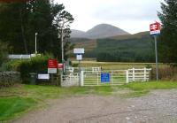 Entrance to Achanalt station in October 2009. View south over the car park alongside the A832 road.  <br><br>[John Furnevel&nbsp;01/10/2009]