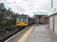 Platform 5 at Wigan North Western, a loop on the west side of the station, sees 142012 newly arrived on an all stations service from Liverpool via St. Helens Central and about to return to Lime Street by the same route. <br><br>[Mark Bartlett&nbsp;21/10/2010]