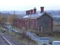 An early wet autumn morning view of the extant former Aberdare High Level station building, looking in very good condition and still with its canopy supports. Photographed looking north from the current <I>modern replacement</I> station in November 2010. [See image 19535] <br><br>[David Pesterfield&nbsp;09/11/2010]