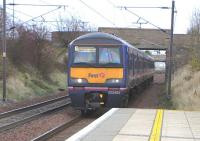 Scotrail may have at last painted their first EMU in saltire livery, <br> but here's one that won't be getting a respray.� 322 482 pulls into <br> Wallyford on 13 November with a North Berwick to Waverley service.� Like the four other members of its Class it'll soon be returning south after spending the prime of its life in Scotland, displaced in the Class 380 rollout. <br> <br><br>[David Panton&nbsp;13/11/2010]
