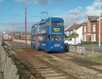 Rebuilt double-deck car 724 heads south from Cleveleys town centre on a service for Blackpool Pleasure Beach. The tracks here are on a reserved section in the middle of a dual carriageway but with several crossing points. [See image 22562] for the same location some eighteen months earlier when the line was closed for refurbishment.<br><br>[Mark Bartlett&nbsp;16/10/2010]