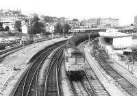 A 47 hauling oil tanks (probably empties) West through Newport in the dim and distant late eighties. Just out of shot to the right is the old goods yard [see image 30821], which was later redeveloped as a shopping centre, while the bus station was revamped over half a mile away. No transport interchange planning there.<br><br>[Ken Strachan&nbsp;/08/1987]