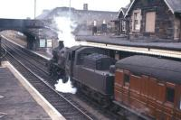 Standard Class 2 2-6-0 no 78047 with the branch train at Kelso in April 1962 preparing to return to St Boswells. Kelso station lost its passenger service in 1964, with the line from Kelso Junction closing 4 years later.<br><br>[Frank Spaven Collection (Courtesy David Spaven)&nbsp;/04/1962]