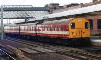 One of the refurbished ex-Great Eastern line 'stop- gap' units no 307130, in West Yorkshire Metro livery, stands at Wakefield Westgate station on 16 September 1990 with a service to Leeds. [See image 32034]<br><br>[David Pesterfield&nbsp;16/09/1990]