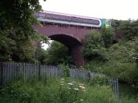 The little known viaduct across the little known River Anker is located between an industrial estate and a heavily wooded part of Riversley Park. So it is rarely photographed. The puddle jumper is the 11.45 from Coventry.<br><br>[Ken Strachan 18/06/2010]