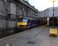 With the yawning, crumpled-looking passengers sent on their way, 90 024 is on the point of pulling out of Waverley's Platform 9 on 20 November with the empty stock of the Caledonian Sleeper from Euston.� The current platforms 8 and 9 originally formed a separate station serving the grandly-named Edinburgh Suburban and South Side Junction Railway's trains.� Even today that wall makes it feel like you are somewhere else, away from the hubbub of the main station.� The awning here is due for a makeover as part of the station's long refurbishment programme.<br><br>[David Panton&nbsp;20/11/2010]