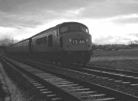 Peak D55 <I>Royal Signals</I> heading north at Stainton Crossing in the late 1960s shortly after leaving Carlisle at the head of the 3.58pm to Edinburgh - with through coaches off the 8.50am ex-St Pancras.<br><br>[K A Gray&nbsp;//]
