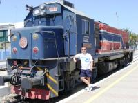 Railscot contributor Colin Harkins standing next to locomotive 550 556 at Bir Bou Regba station in Tunisia on 22 August 2010. This loco ran on 1m gauge track.<br><br>[Colin Harkins&nbsp;22/08/2010]