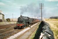B1 4-6-0 no 61357 takes a westbound freight through Saughton Junction in August 1959. From the setting of the junction signal the train is about to cross over to the Fife lines and head north.<br><br>[A Snapper (Courtesy Bruce McCartney)&nbsp;26/08/1959]