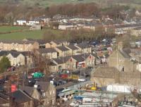 Clitheroe station, as seen from the ramparts of the Norman keep. The original building, now an art gallery, is in the centre of the picture and the replacement booking office can just be seen to its right. For the view from the station up to the castle [See image 30769]<br><br>[Mark Bartlett&nbsp;27/11/2010]