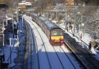 320 312 pulls into a snowy Alexandra Parade station on 27 November with a Springburn to Dalmuir service.� <br> <br><br>[David Panton&nbsp;27/11/2010]