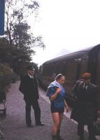 The guard of a Ballachulish-bound train watches passengers disperse at Ballachulish Ferry station, thought to be in the summer of 1965, with the mountains of Glencoe in the distance. The station closed along with the rest of the branch in March 1966. <br><br>[Frank Spaven Collection (Courtesy David Spaven)&nbsp;//1965]