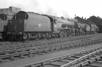 Scene on Kingmoor shed in June 1962 with Stanier Pacific no 46201 <I>Princess Elizabeth</I> nearest the camera and <I>Crab</I> no 42882 standing beyond.<br><br>[K A Gray&nbsp;07/06/1962]