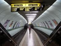 The bigger stations on the Glasgow Subway have platform walls in the <br> same neutral colour and pale yellow signage strip.� However no two <br> single-island stations are in the same colour.� Some are almost garish, but Cowcaddens, seen here on 27 November, has gone for a restrained mint green with an olive dado.<br><br>[David Panton&nbsp;27/11/2010]