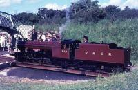 Brand new for that season 2-8-2 <I>River Mite</I> is seen on the turntable at Ravenglass in summer 1966 being made ready for another run up to Dalegarth. Forty four years later she is still in regular use on the line and must have repaid the investment in her many times over. <br><br>[David Hindle&nbsp;/07/1966]