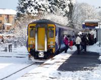 <I>Careful now - mind you don't slip.. </I> Passengers tentatively  disembarking from a Glasgow Central arrival at a snowy East Kilbride station during the late morning on 2 December 2010<br> <br><br>[John Steven&nbsp;02/12/2010]