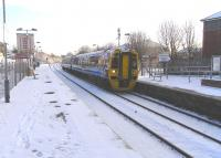 The euphonious, alliterative and plurally plosive Possilpark & <br> Parkhouse on the Maryhill line.  A snow-capped 158 872 calls on its way to Anniesland on 27 November.<br> <br><br>[David Panton&nbsp;27/11/2010]