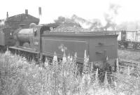 Hawick D34 4-4-0 no 62484 <I>Glen Lyon</I> simmers on Canal shed, Carlisle, in the summer of 1961. The locomotive had arrived at Hawick shed from Perth following a period in store at Dundee West [see image 28841]. Final withdrawal from Hawick came at the end of November 1961.<br><br>[K A Gray 01/07/1961]