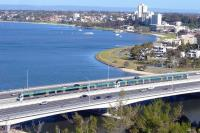 View from King's Park over South Perth with a Transperth emu bound for Mandurah in September 2010. These trains do not serve Perth Central, instead burrowing down a new line via Perth Underground and Esplanade stations. This line is of recent construction and uses the median of the freeway at this point.<br> <br><br>[Colin Miller&nbsp;26/09/2010]