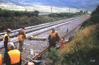 A permanent way gang welding rails south of Dalwhinnie as part of the track redoubling work to Blair Atholl in the summer of 1976.<br><br>[Frank Spaven Collection (Courtesy David Spaven)&nbsp;//1976]