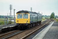 A Lowestoft to Norwich DMU calls at Haddiscoe (Low Level) on June 30th 1979. The platform lighting columns had been recycled from the former station at Yarmouth South Town - the name could be seen embossed on the lamp shades.<br><br>[Mark Dufton&nbsp;30/06/1979]