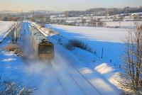 170 401 heads south towards Inverkeithing East Jct on 7 December 2010 leaving snow in its wake.<br> <br><br>[Bill Roberton&nbsp;07/12/2010]