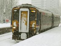 156476 arriving at Pollokshaws West in heavy snow on 6th December on a Glasgow Central service<br><br>[Graham Morgan&nbsp;06/12/2010]