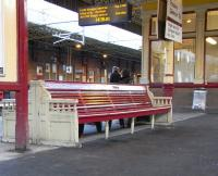 A close up of the venerable bench on the central platforms at Gilmour Street, photographed on 27 November 2010.� Generations of people have waited for their trains on it, surely including larking young men in uniform who would never live to sit there in civvies.� Makes you think, doesn't it?<br><br>[David Panton&nbsp;27/11/2010]