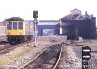 A DMU leaves Workington in May 1991. Despite the destination blind the train is heading south.<br><br>[Ian Dinmore&nbsp;/05/1991]
