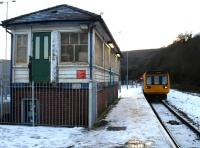 Pacer 142074 passes the redundant junction signal box as it runs into Abercynon on 9 December to form the 15.43 service to Merthyr Tydfil.<br><br>[David Pesterfield&nbsp;09/12/2010]