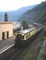 The afternoon train from Kyle to Inverness pulls out of the once-imposing station at Stromeferry in the summer of 1983. Attached at the rear of the train is ex-GWR coach no 9004 which was used as an observation coach on the line during the summer in the early 1980s. <br><br>[Frank Spaven Collection (Courtesy David Spaven)&nbsp;//1983]