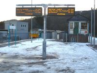 The 15.08 mixed Pacer service from Merthyr Tydfil seen between the old and new 'signalling centres' at Abercynon on 9 December 2010. The train continues south from here as the 15.29 service to Barry Island [see image 25614].<br><br>[David Pesterfield&nbsp;09/12/2010]