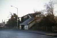 The frontage of Croxley Green LNWR station on Christmas day 1976. Originally, there was a road level booking hall similar in style to that at Watford West at the foot of the steps. This was demolished for road widening in the 1960s. The track formation was also cut back - it used to extend beyond the station into an industrial site. The structure seen here lasted until 1989.<br><br>[Mark Dufton&nbsp;25/12/1976]