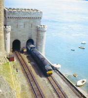 A class 40 skirts Conwy Castle in the 1970s with a train for Holyhead.<br><br>[Jim Peebles&nbsp;//]