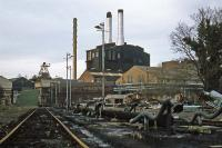 The last substantial section of the LNWR Watford to Rickmansworth branch to survive in traffic served John Dickinson's Croxley paper mill for the delivery of fuel oil. This view of the mill, taken on 26th December 1977, shows the sidings and transshipment facilities. Trains ran until the mill closed in December 1980, after which it was demolished for new housing.<br><br>[Mark Dufton&nbsp;26/12/1977]