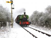 Scene on the Swindon and Cricklade Railway near Hayes Knoll on 18 December with Barclay 0-6-0ST <I>Salmon</I> heading through the snow with a <I>Santa Special</I>.<br><br>[Peter Todd&nbsp;18/12/2010]