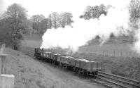 <I>Careful with that!</I>  0-4-0ST <I>Dailuaine</I>, seen here in charge of a precious cargo near the Dailuaine distillery between Carron and Aberlour on the Speyside line in the 1960s.<br><br>[Robin Barbour Collection (Courtesy Bruce McCartney)&nbsp;//]