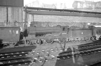 D30 <i>Scott</i> class 4-4-0 no 62423 <I>Dugald Dalgetty</I> stands next to the shed tool van at Hawick on Christmas Eve 1957.<br><br>[Robin Barbour Collection (Courtesy Bruce McCartney)&nbsp;24/12/1957]