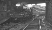 <i>Nice engine - shame about the headboard!</i> A3 60052 <I>Prince Palatine</I> takes on water alongside the east end signal box at Dundee Tay Bridge station on 4 September 1965. The Pacific was hauling the LNER Society's <i>'LNER Pacific Tour'</i>, which was en route to Aberdeen. <br><br>[K A Gray&nbsp;04/09/1965]