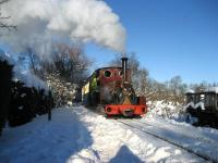 In bright sunshine Quarry Hunslet no 823 <I>Irish Mail</I> brings children (of all ages) through the snow back from <I>Toyland</I> to Becconsall on the West Lancashire Light Railway on 19 December 2010.<br> <br><br>[John McIntyre&nbsp;19/12/2010]