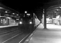 A night time passenger service calls at Osnabruck in 1976, hauled by 141 430-9.<br> <br><br>[John McIntyre&nbsp;//1976]