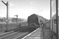 Stanier Coronation Pacific no 46247 <I>City of Liverpool</I> photographed at the south end of Beattock station on 15 April 1963 heading the 10am Euston - Perth train. The train will shortly draw to a halt in order to take on banking assistance. <br><br>[K A Gray&nbsp;15/04/1963]