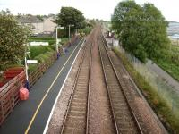 Looking east from the footbridge at Balmossie on 19 September 2007.  <br> The shortness of the platforms exaggerates the stagger.  If one platform were to warrant a shelter it would be the Dundee-bound one, but the tiny number of people each year catching the daily train the other way do at least get a bench.  For a picture of one of those trains a few years earlier [see image 16711].<br> <br><br>[David Panton&nbsp;19/09/2007]