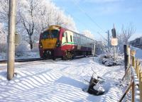 An Edinburgh Waverley - Helensburgh Central train formed by 334 001 heads west from Airdrie station on the afternoon of 23 December 2010.<br><br>[John Steven&nbsp;23/12/2010]