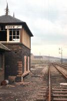 Crew Junction box is in poor shape in this 1966 view, some nine months after closure. Despite appearances, the line from Coltbridge Junction to Leith North (the right hand track) was still open for freight, but would succumb a year later. The name board was subsequently purchased from British Railways by the photographer. <br><br>[Frank Spaven Collection (Courtesy David Spaven)&nbsp;//1966]