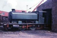 The last day of rail operations at Millom Ironworks sees Barclay<br> 0-4-0ST No.1 (Works No. AB 2333/1953) standing outside the locomotive shed. Now preserved on the Lakeside & Haverthwaite Railway as <I>'David'</I> it still carries that fine looking number plate. The loco shed, built in 1944, is still in use as a factory making nylon brush bristles. (Thanks to Chris Moore for additional information.)<br><br>[David Hindle&nbsp;19/09/1968]